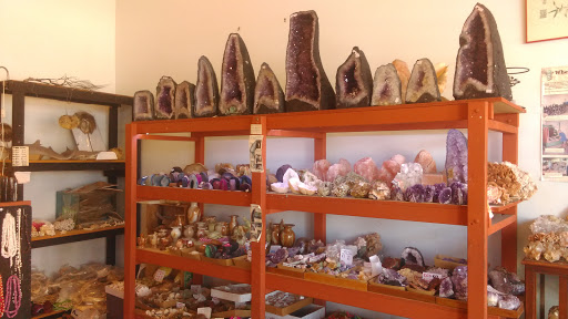 Photo of shelves full of crystals, colourful rocks, and more